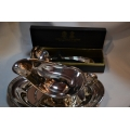 A set of silver plated sauce boat and laddle